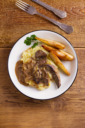 Beef liver with pears and mashed potato. View from above, top studio shot Banco de Imagens
