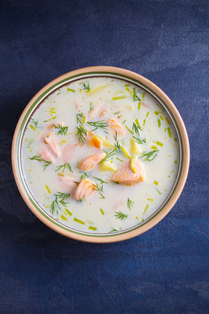Salmon soup. Creamy  salmon fish soup in bowl. overhead, vertical