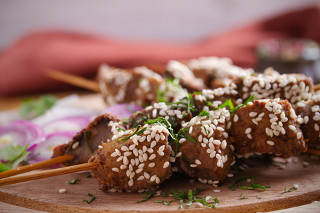 Beef liver on skewers with sesame seeds on wooden tray. Liver Kebab, kabob - image