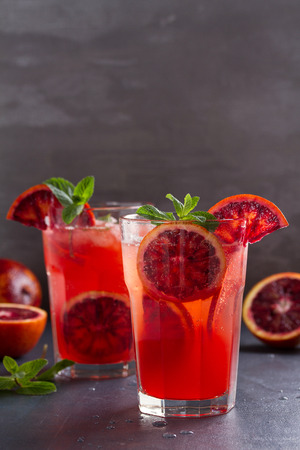 Blood orange cocktail with slices of citrus fruits and mint. room for text  Banque d'images