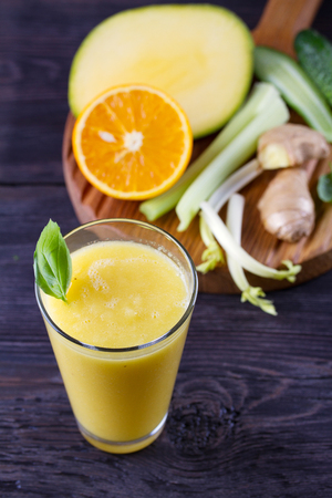 Orange Mango Ginger Smoothie. Fruit and Vegetable Smoothie - healthy diet and detox drink