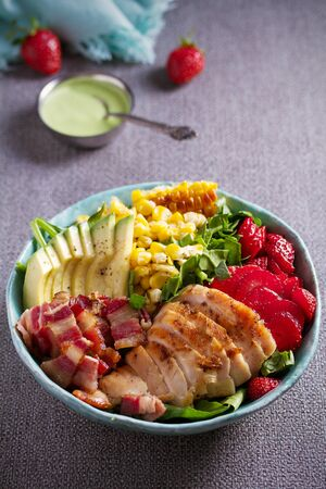 Chicken Cobb Salad. Chicken bacon avocado strawberry and sweet corn salad - healthy food