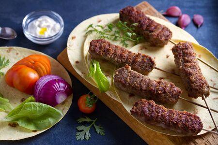 Kofta kebabs with pita bread, vegetables and yogurt sauce Stock Photo