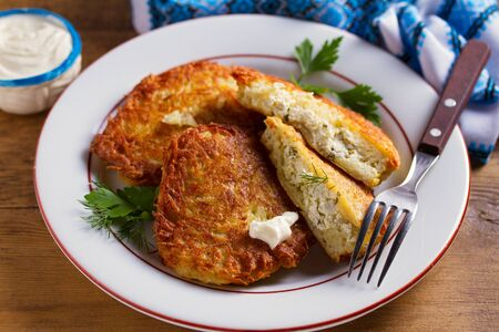 Potato Pancakes Filled With Cheese. Vegetable fritters stuffed with cottage cheese