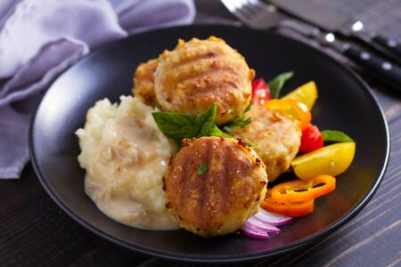 Fish cakes with mashed potatoes and vegetables. Fish patties. Fried cutlets of minced fish