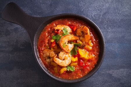 Shrimp Gazpacho with Roasted Red and Yellow Bell Peppers. Spanish pureed cold tomato soup with shrimps