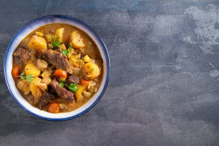 Slow cooker thick and chunky beef stew. View from above, top, copy space Stock Photo