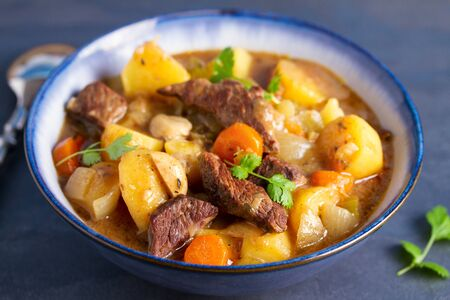 Slow cooker thick and chunky beef stew Stock Photo - 133814759