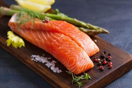 Fresh raw salmon fish fillet, asparagus, lemon, herbs and spices Stok Fotoğraf