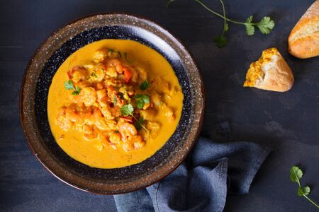 Creamy rich spicy shrimp curry. Seafood dish. View from above, top view