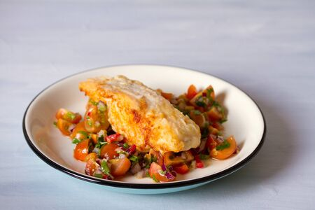 Pan fried cod fish with tomato salsa