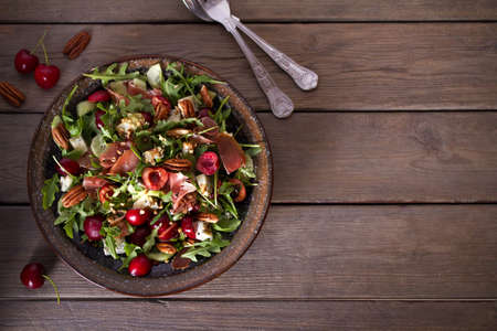 Strawberry and prosciutto salad with gorgonzola cheese and arugula. Healthy food. Overhead horizontal photo, copy space