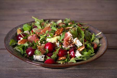 Strawberry and prosciutto salad with gorgonzola cheese and arugula. Healthy food. horizontal photo