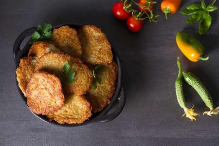 Potato Cakes. Vegetable fritters, latkes, draniki. Vegetable pancakes. View from above, top studio shot