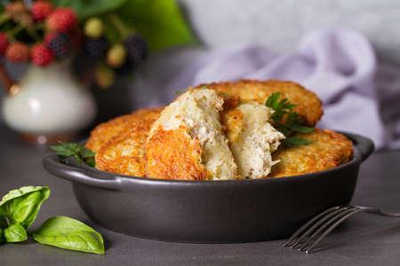 Potato Cakes with beef meat filling. Vegetable fritters, latkes, draniki. Vegetable pancakes