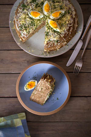 Layered liver cake with cheese, mayonnaise and dill. Savory cake. Overhead vertical photo Imagens