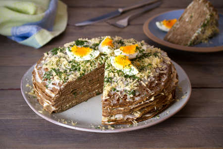 Layered liver cake with cheese, mayonnaise and dill. Savory cake. horizontal photo Imagens
