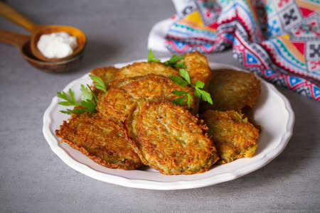 Potato cakes. Vegetable fritters, pancakes, latkes - dish consisting of pan fried shredded potatoes.