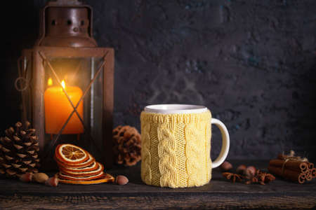 Autumn Thanksgiving Background with lantern, dried fruits and knitted cup. Winter holidays composition