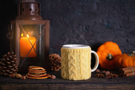 Autumn Thanksgiving Background with lantern and knitted cup. Winter holidays composition