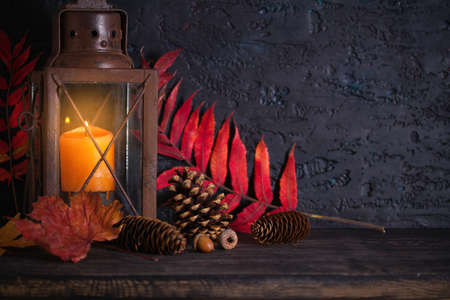 Autumn Thanksgiving Background with lantern and autumn leaves. Winter holidays composition