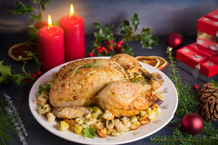 Roasted chicken stuffed with apple bread and celery. Christmas dinner table 写真素材