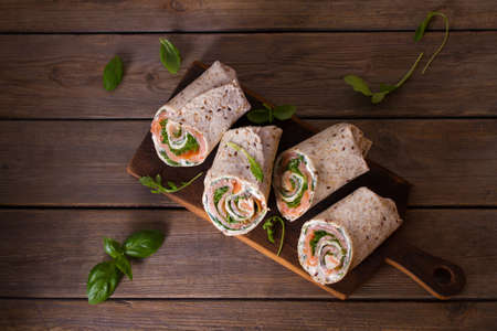 Salmon and cream cheese wraps. Rolls with smoked salmon. Homemade tasty burrito