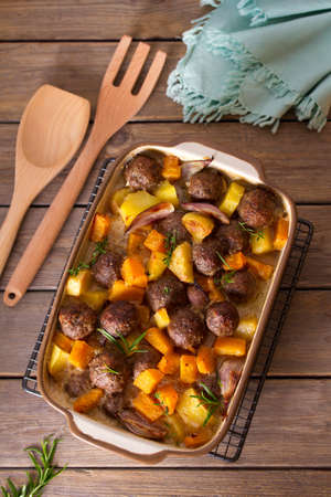 Meatballs with butternut squash and potatoes. View from above, top view