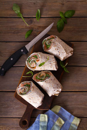 Salmon and cream cheese wraps. Rolls with smoked salmon. Homemade tasty burrito
