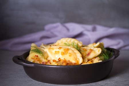 Dumplings, filled with potato. Pierogi, varenyky, vareniki, pyrohy - dumplings with filling, popular dish in many countries Stock fotó