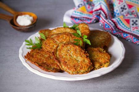 Potato cakes. Vegetable fritters, pancakes, latkes on white plate