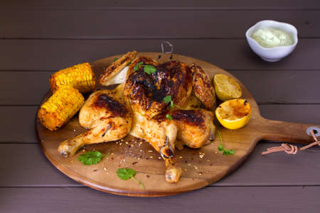 Spatchcocked chicken with sweet corn and yoghurt sauce
