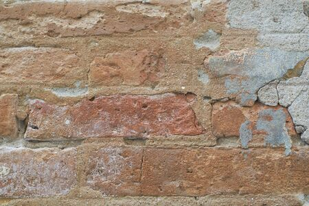 residue: Background texture of old brown brick with cement residue