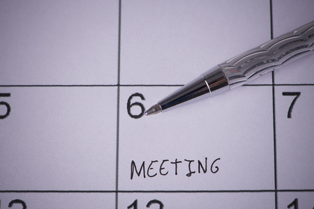Marked by a pen Calendar With the written word meeting Stock Photo