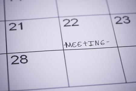 denote: Word written on a calendar meeting