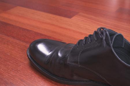 chamois leather: Shoe on wood Stock Photo