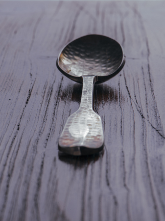 grunge silverware: old wooden spoon over