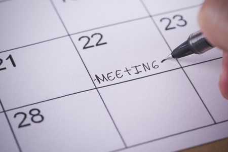 scheming: Marked by a pen Calendar With the written word meeting Stock Photo