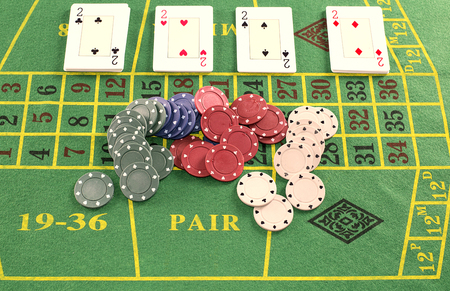 green carpet: Deck of cards with pieces of poker on green carpet
