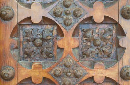 luxuriously: An old carved wooden door