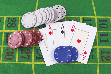 aces: Aces and poker rooms on green carpet