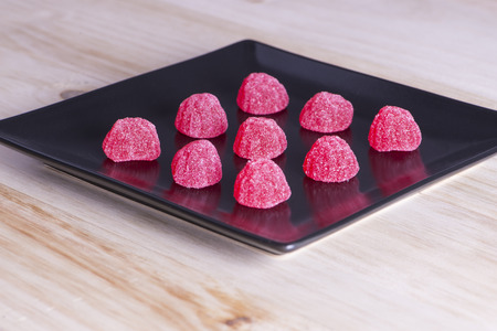 nicked: Sweets strawberry on black dish
