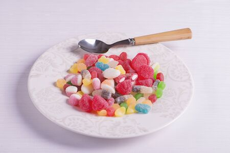thai dessert: Plate with a spoon full of candies
