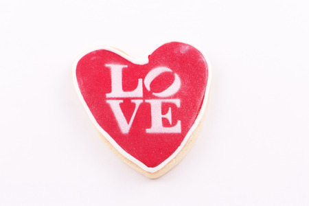written: Heart-shaped cookie and Love written Stock Photo