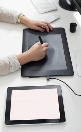 wacom: Woman hands using a graphics tablet Stock Photo