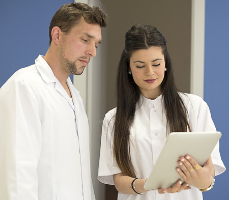 a lady doctor: Young attractive doctor teaches the tablet and attractive young doctor