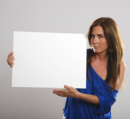 Woman with long hair while holding a white board