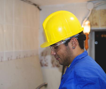 yellow helmet: Construction worker with yellow helmet