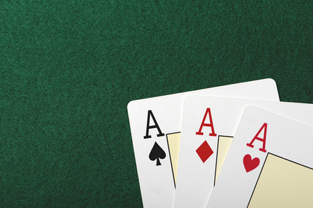 Three aces on the green table of a casino. Poker. Stock Photo