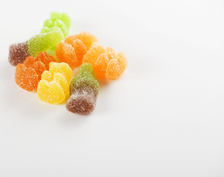 Sweets of various flavors. Isolated. Horizontal shoot.